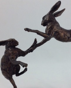Bronzes boxing hares